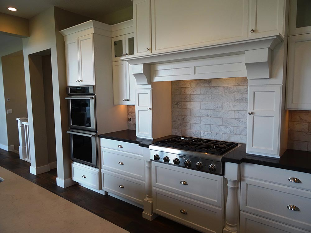 Kitchen with gas range top and double ovens