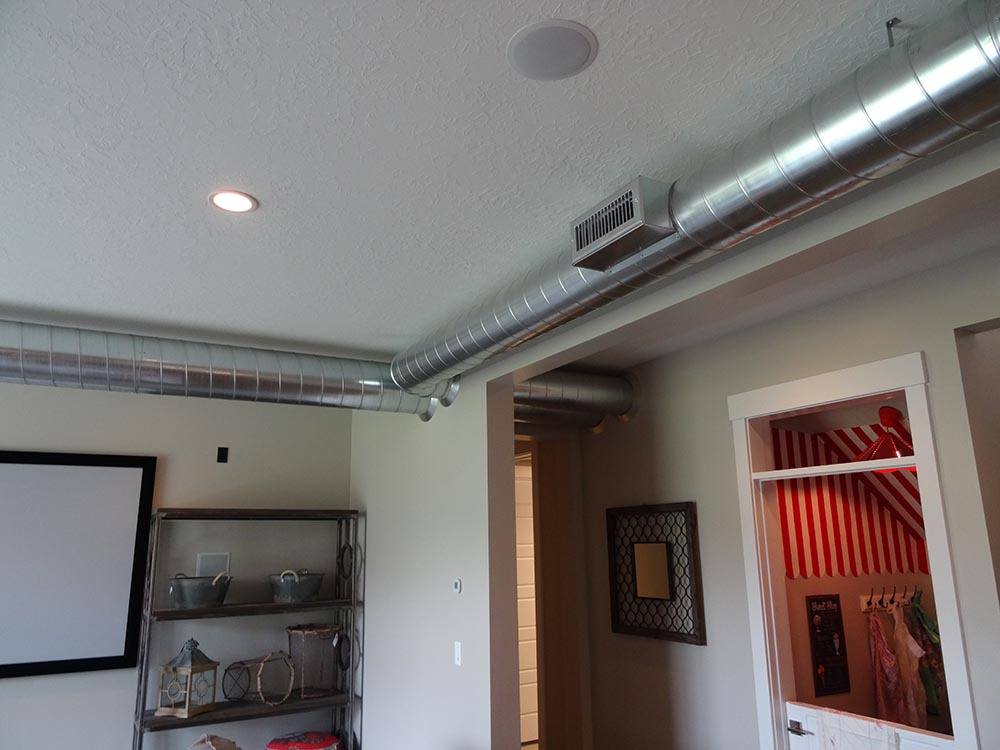 Basement Family Room with exposed heating vents