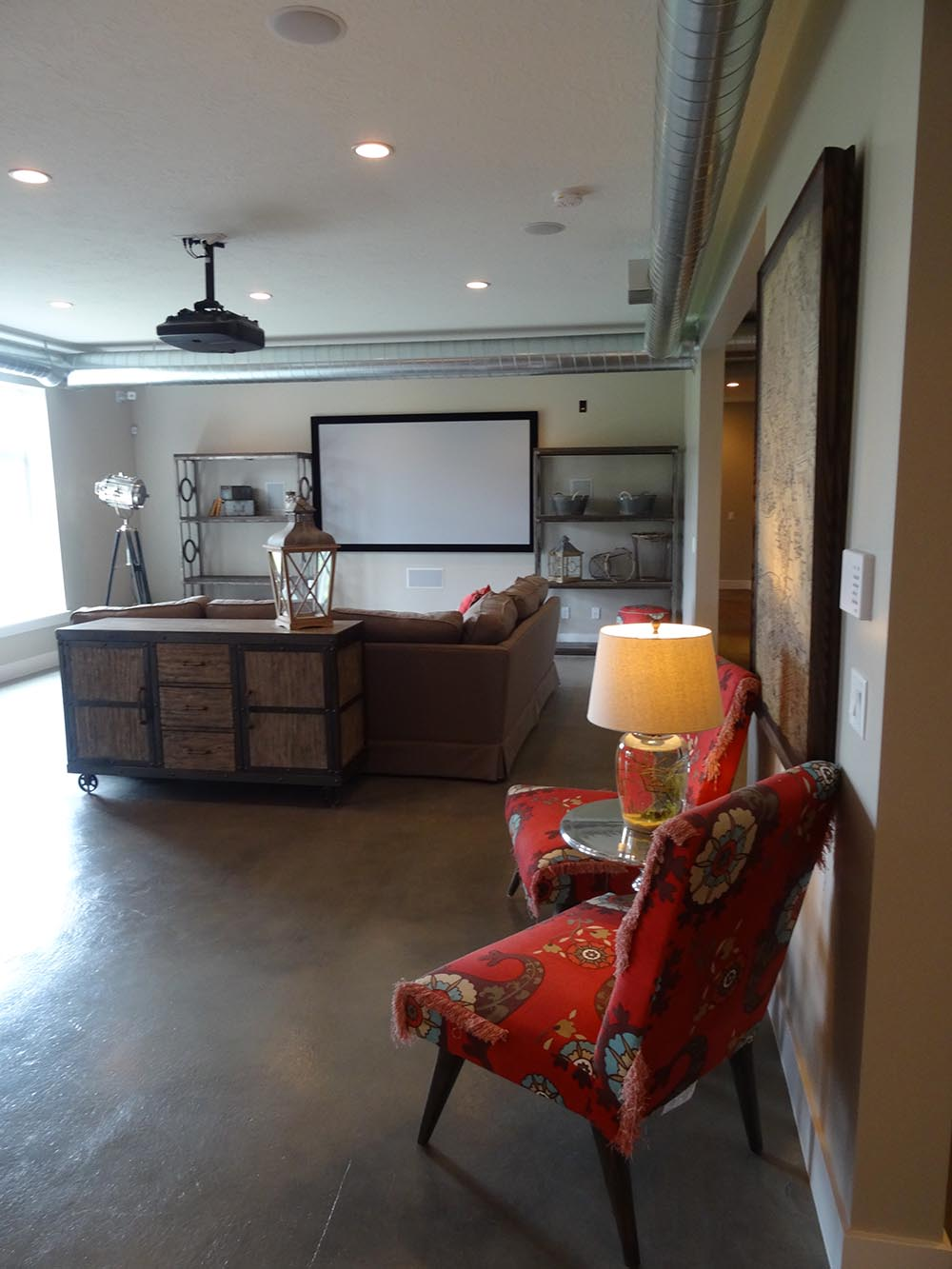 Basement Family Room with concrete flooring